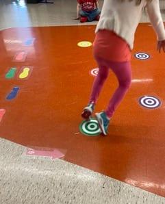 Girl traveling down a sensory path at school