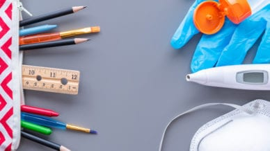 School supplies with medical mask, digital thermometer, surgical glove, and hand sanitizer.