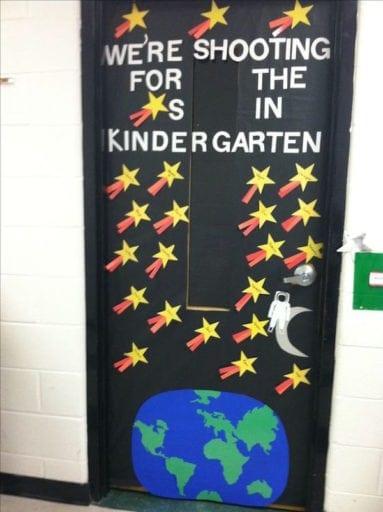 Black Kindergarten classroom door decorated and stars and planet