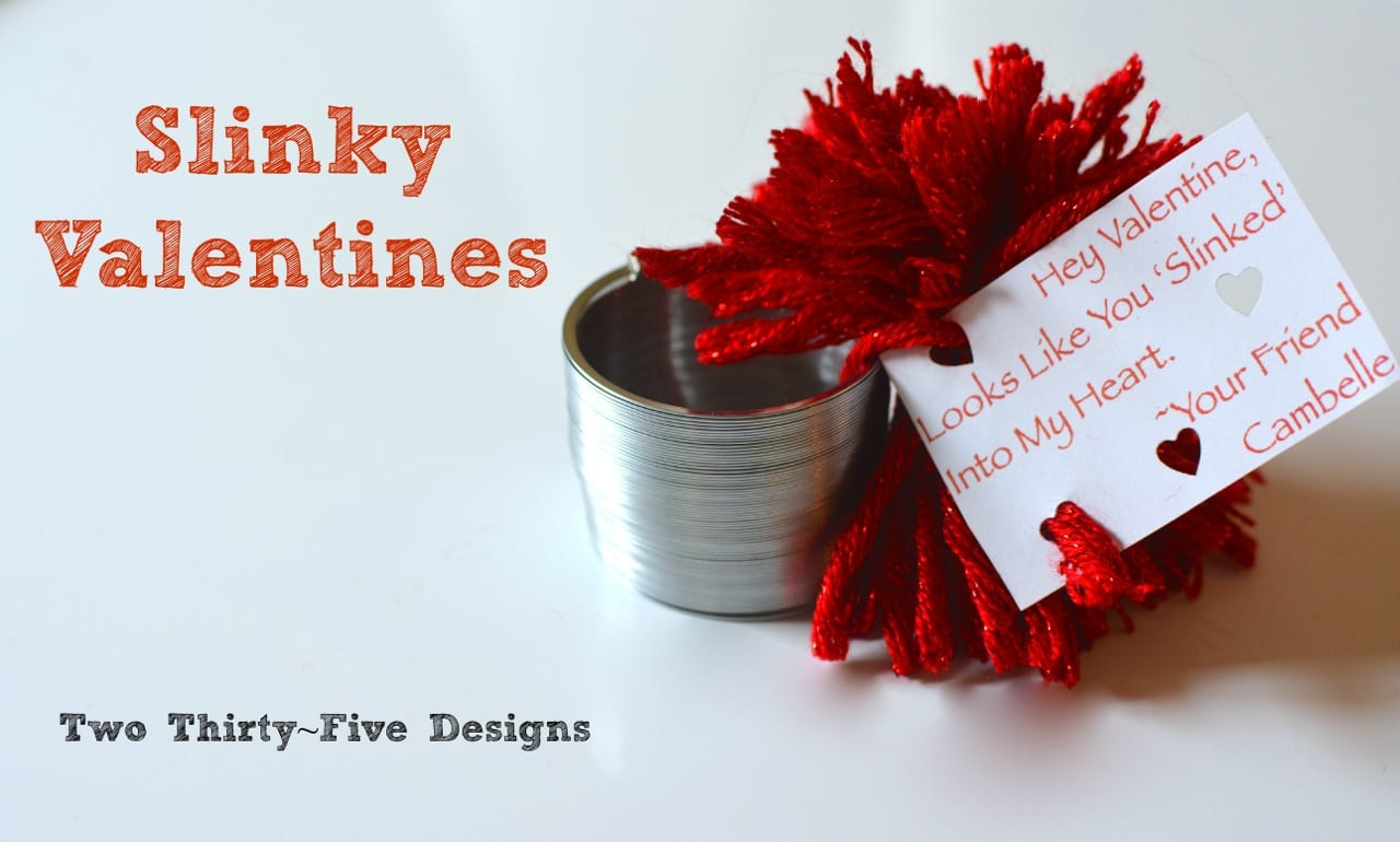 """Slinky valentines, a slinking with a red yarn bow and a card that says, """"Hey Valentine, Looks Like You 'Slinked' Into My Heart."""""""
