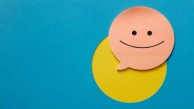 Smiley face on sticky note