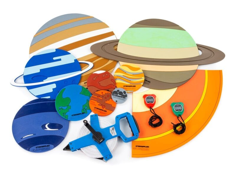 colorful components of a solar system experiment kit for students