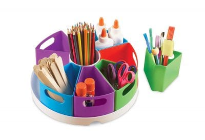 Tub with colored baskets filled with second grade classroom supplies