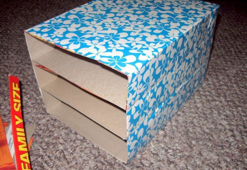 Old cereal boxes covered with decorative paper to use as classroom student mailboxes