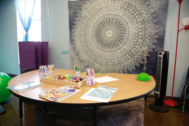 Mindfulness coloring table with books and crayons/markers.
