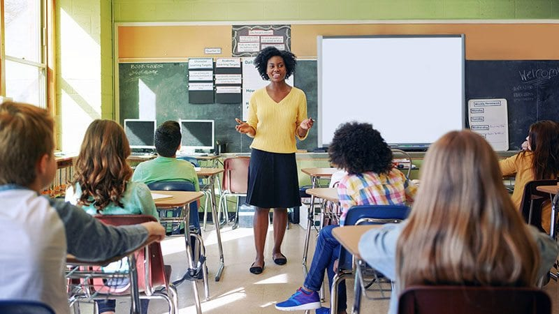 Teacher talking to middle school class