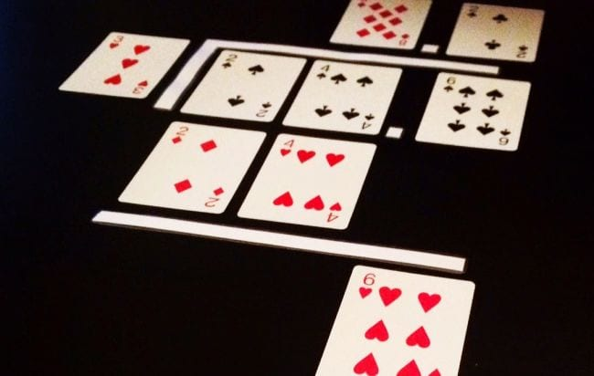 Playing cards laid out to represent a long division problem