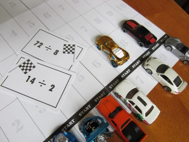 Toy cars with division problem cards and game board