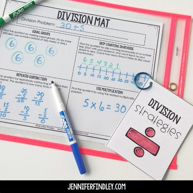 Division Mat worksheet in a sheet protector with markers