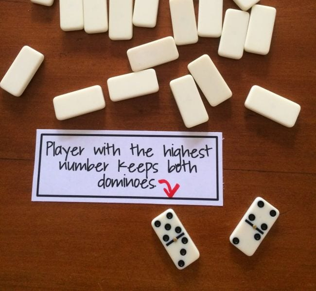 "Upside-down dominos with two flipped over next to card reading ""Player with the highest number keeps both dominos"" (Third Grade Math Games)"