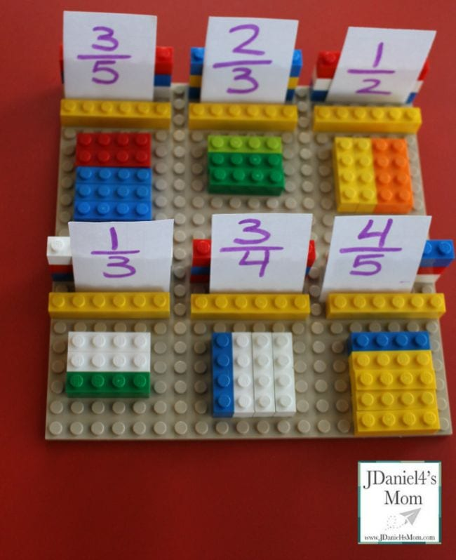Lego bricks laid out to represent fractions with cards showing the fractions