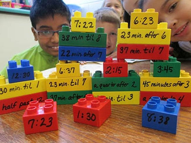 Students stacking Duplo blocks with times written on them (Third Grade Math Games)