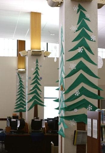 Classroom pillars decorated with cutout tree decorations