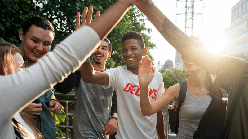 Teens high-fiving
