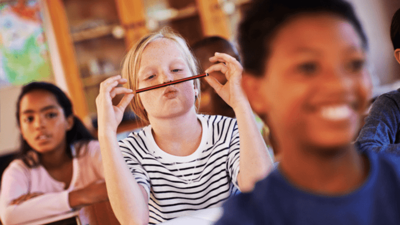 Trauma-Informed Classroom: Student misbehaving with a pencil in classroom