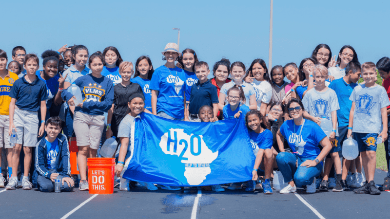 Group of students posing for photo at H2O for Life Walk for Water Service Learning Project