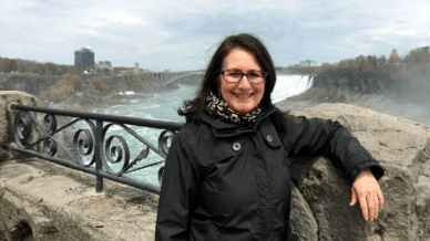 Teacher Standing on a Bridge - Meet a National Geographic Explorer