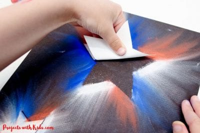Star-shaped stamp on colored paper.