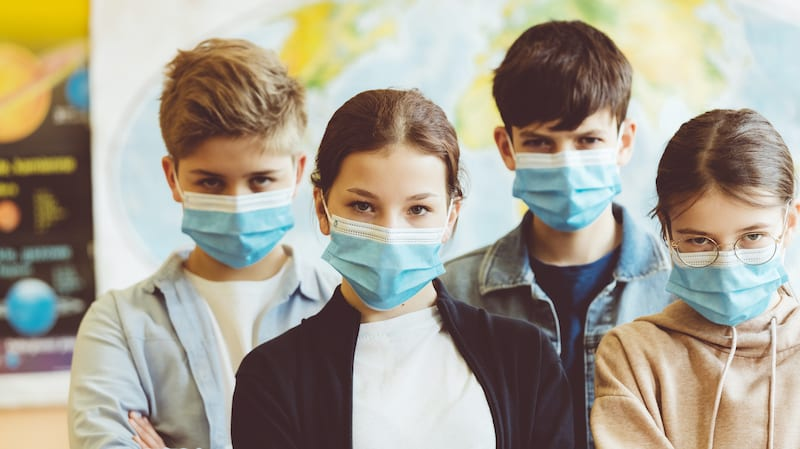 Group of high school students at school wearing N95 Face masks