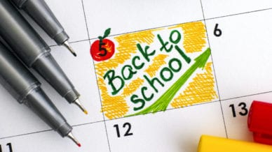 Reminder Back to School in calendar with colour pens.
