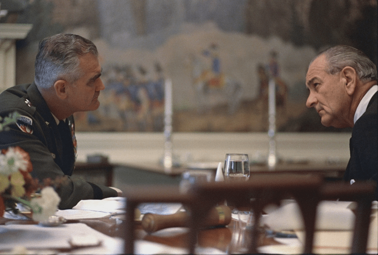 General William Westmoreland and President Lyndon B. Johnson sitting at table