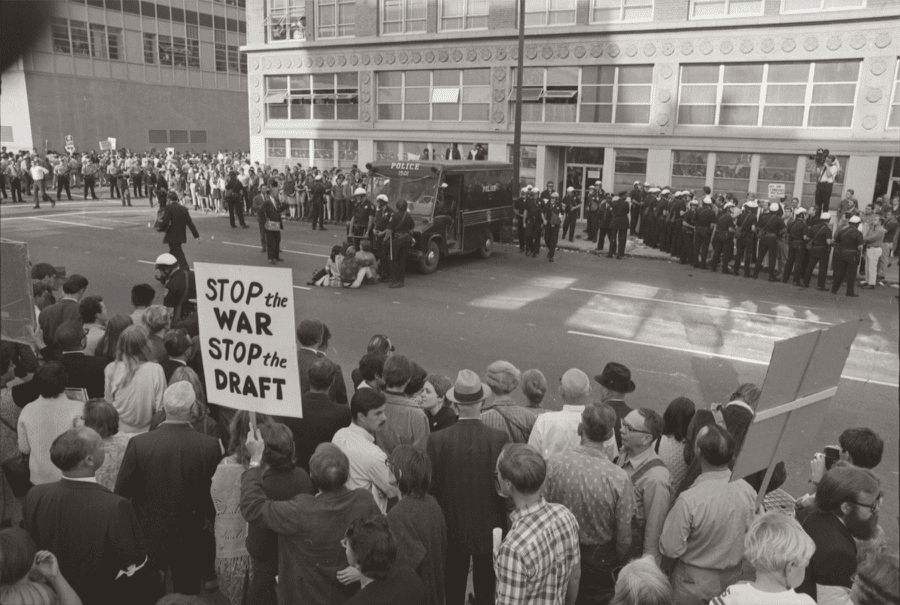 Antiwar protestors gather outside an Army induction center