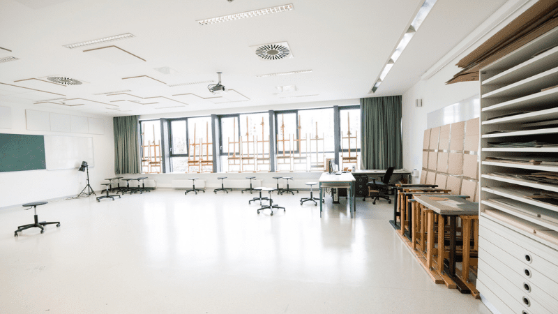 Empty classroom with chairs pushed to the side