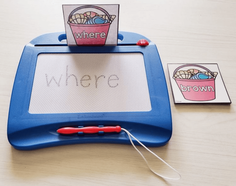 Write words on a magnetic drawing board
