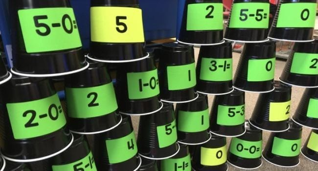 Plastic cups with math problems and numbers, stacked into a pyramid (Active Math Games)