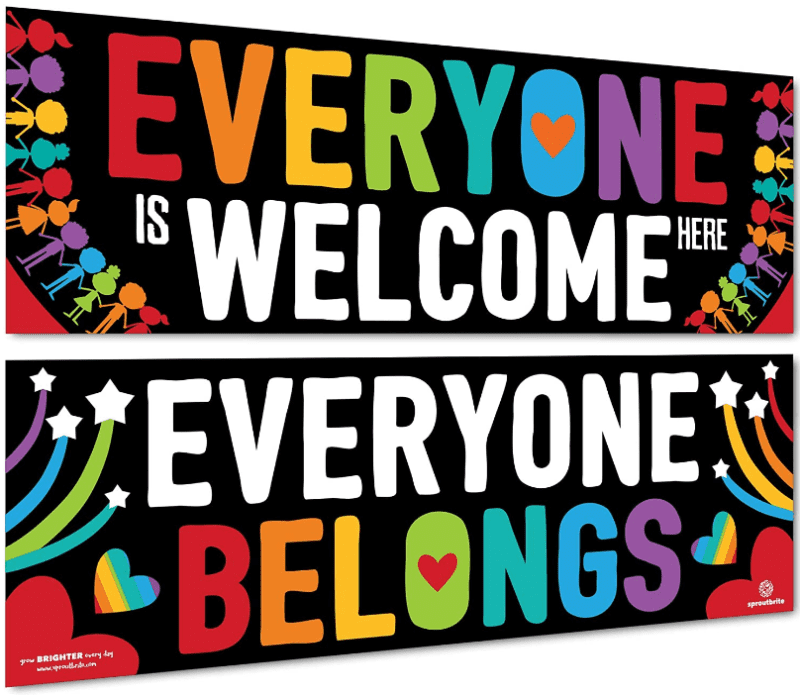 """Two colorful banners, one reading """"EVERYONE IS WELCOME HERE"""" and the other reading """"EVERYONE BELONGS."""""""