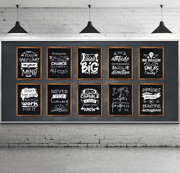10 graphics of motivational posters on a middle school classroom décor chalkboard wall in a cinderblock room with lights hanging from the ceiling.