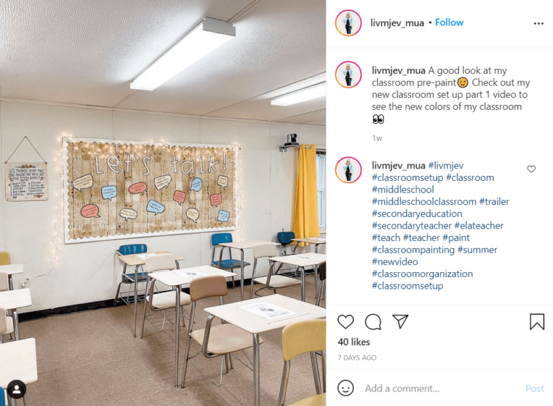 """A middle school classroom décor bulletin board decorated with faux wood features the words """"Let's Talk"""" and what appear to be conversation prompts. Student desks are in the foreground."""