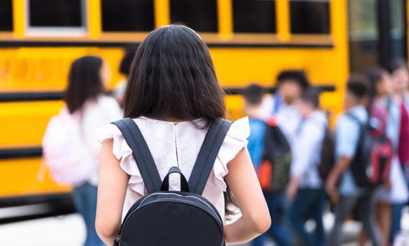 children loading the bus for school