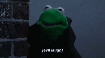 Kermit the Frog in a black cape with text (evil laugh)
