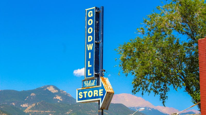 Goodwill store sign with mountains in the background. Photo by Nosiuol on Unsplash. (Teacher Bargain Shopping Guide)