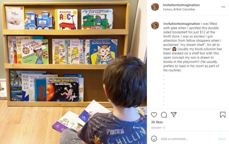Instagram post showing child reading a book in front of a small wooden bookshelf