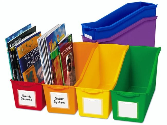Rainbow colored book bins with white labels on the front