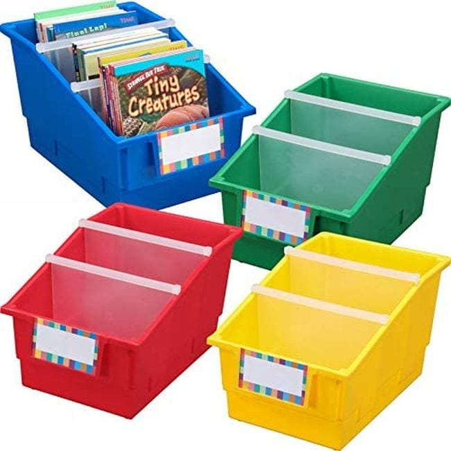 Large divided book bins in red, yellow, blue, and green