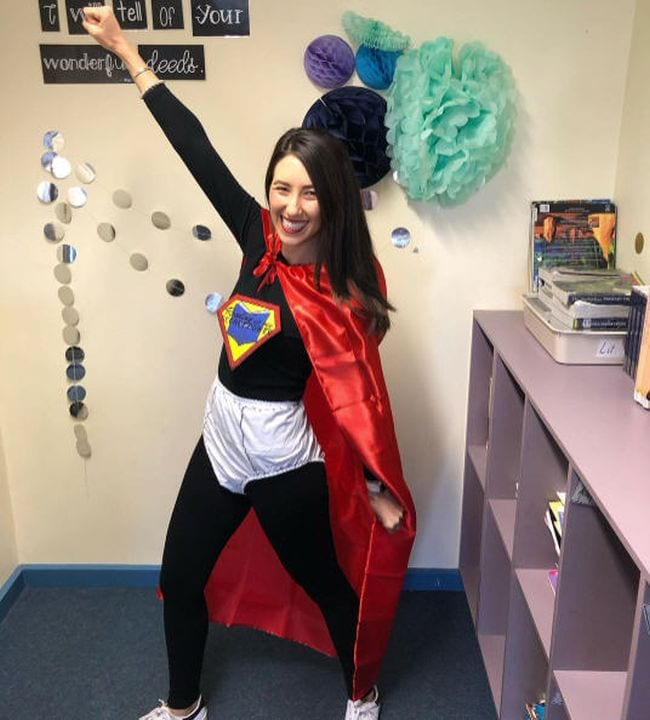 Woman in a black bodysuit with large pair of underpants, red cape, and Captain Underpants logo (Book Character Costume Ideas)