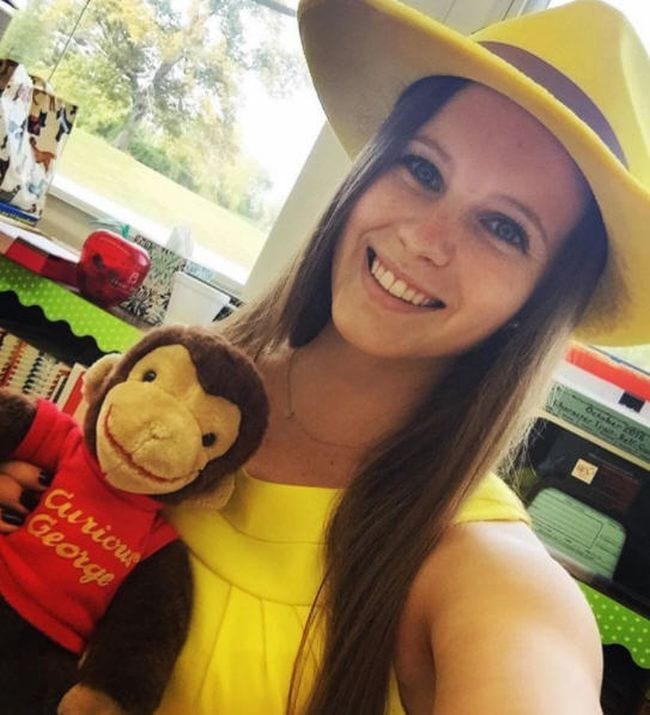 Woman wearing a bright yellow fedora and carrying a Curious George stuffed animal (Book Character Costume Ideas)