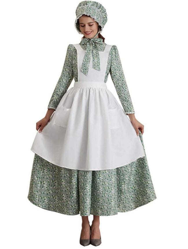Woman wearing green pioneer dress, white apron, and matching sunbonnet (Book Character Costume Ideas)