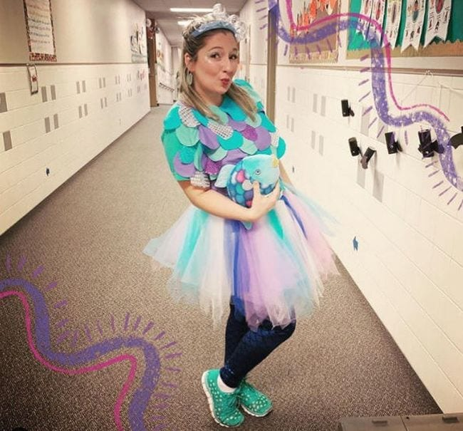 Teacher dressed in colorful tutu and aqua shirt covered in pastel fish scales (Book Character Costume Ideas)
