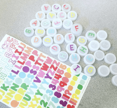 Use bottle caps and sticker as classroom tool