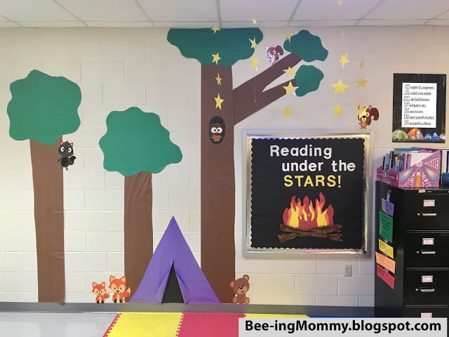 Tree, tent, and campfire wall decor for classroom