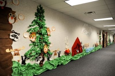 Woodland school hallway decorations with trees and owls