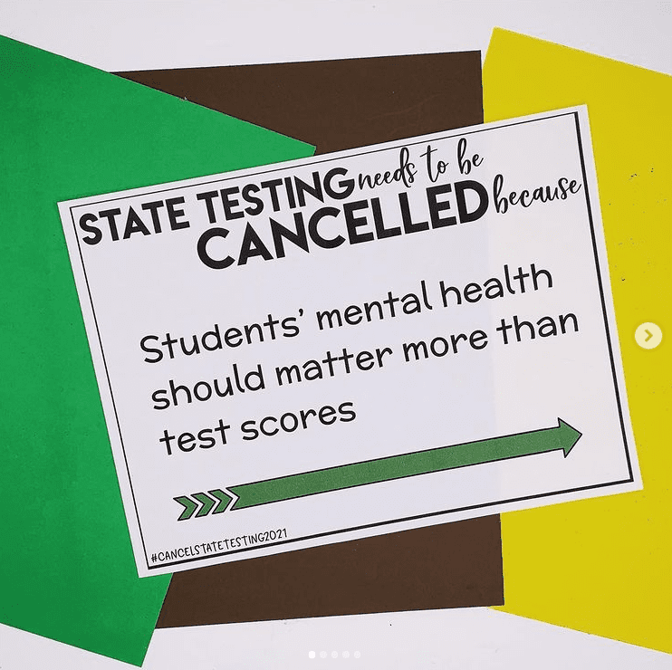 Teacher sign against testing students during pandemic