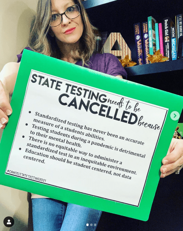 Teacher holding sign to support canceling state testing