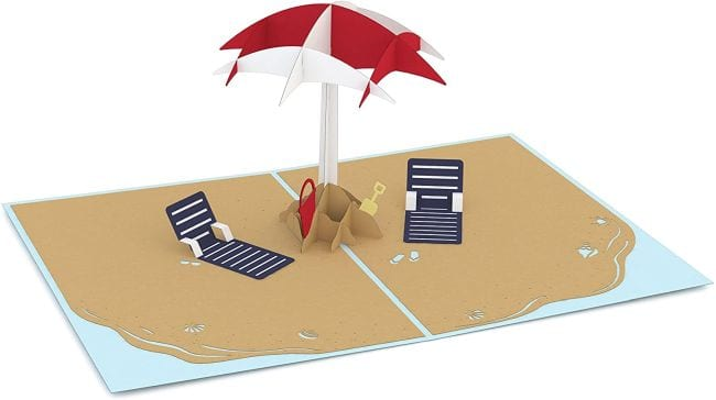Pop up card of a beach scene with chairs and umbrellas