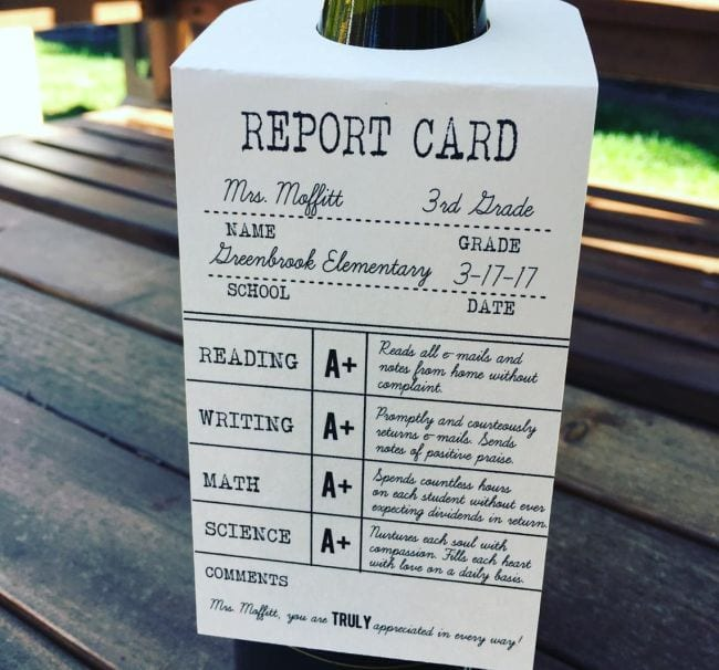 Teacher thank you card made to look like a report card hanging from a bottle of wine