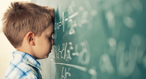 Child with head against chalkboard